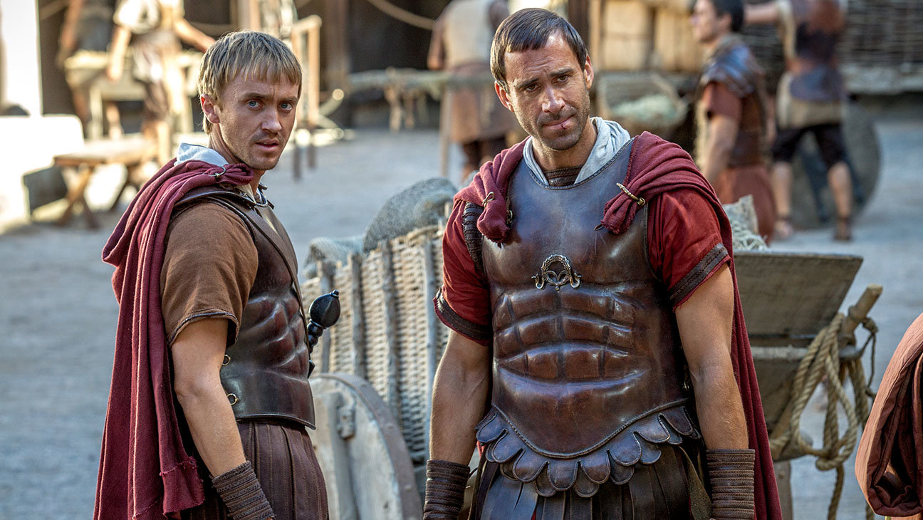 Clavius (Joseph Fiennes) and Lucius (Tom Felton) at the Roman barracks consider new information from the bystander about the apostles in Columbia Pictures' RISEN.